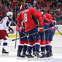 Matt Niskanen #2 of the Washington Capitals celebrates with teammates after scoring a goal against the Columbus Blue Jackets during the second period at Capital One Arena on November 9, 2018 in Washington, DC. (Patrick Smith/Getty Images via JTA)