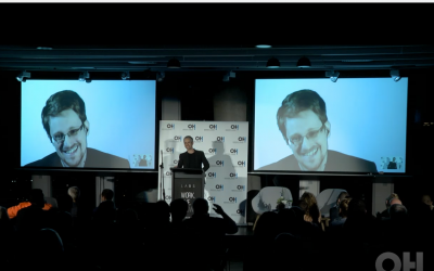 Edward Snowden speaks to journalists and invited guests at a Tel Aviv event produced by the Orenstein Hoshen PR agency (Courtesy)