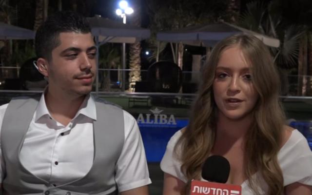 Raziel (left) and Yael Huri after their wedding on Monday night, November 12, 2018 (Hadashot TV news)