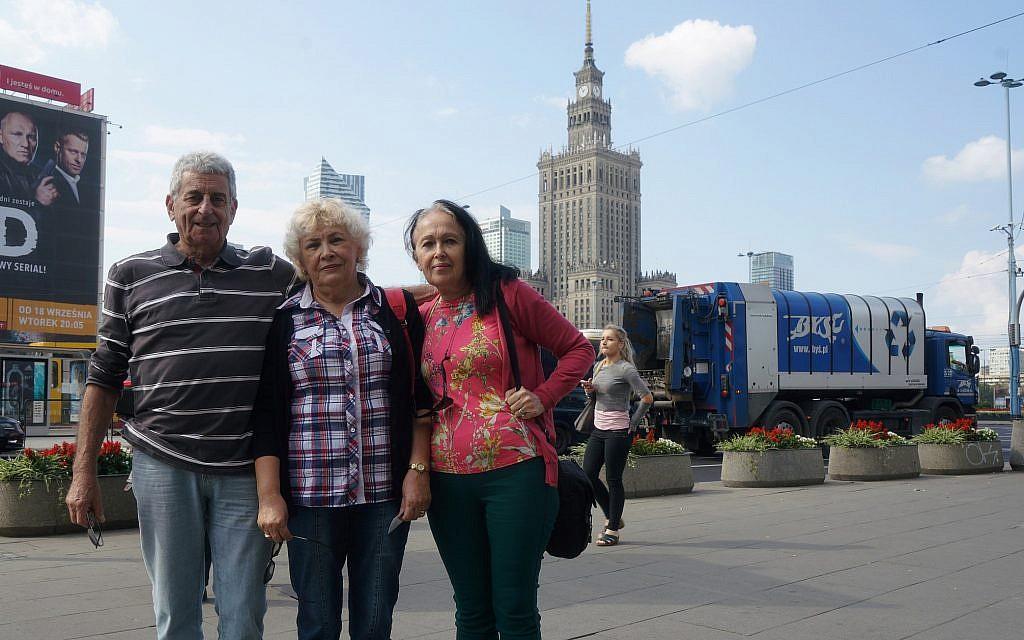 Sarah Hirsch, right, with her husband, Naftali, and friend Gabby Schwartz arriving at a Warsaw hotel, September 6, 2018. (Cnaan Liphshiz/JTA)