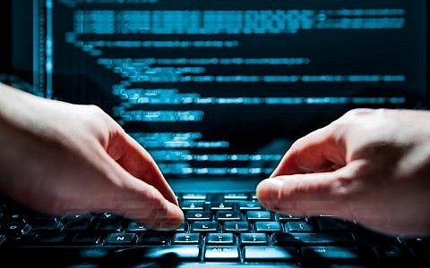 Illustrative image of a hacker and online fraud (scyther5; iStock by Getty Images)