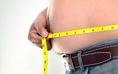Illustrative: A man measuring his belly. (iStock by Getty Images)