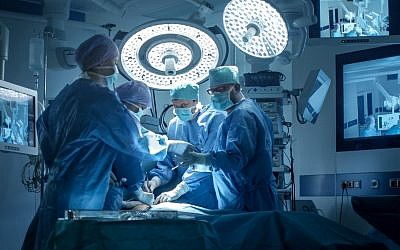 Illustrative: A medical team performs surgery in a modern operating room. (gorodenkoff; iStock by Getty Images)