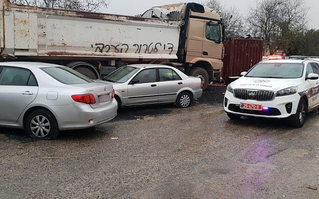 Cars damaged in East Jerusalem alongside a truck graffitied with the words 'No more Arab terrorism,' November 23, 2018 (Israel Police spokesperson)