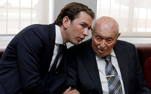 Austrian Chancellor Sebastian Kurz speaks to an Israeli Holocaust survivor from Austria in Jerusalem, June 10, 2018. (Gali Tibbon/AFP/Getty Images/via JTA)