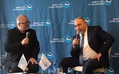 Former defense minister Avigdor Liberman right) addressing a conference in Netanya, November 22, 2018. (Screenshot)