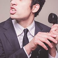 Illustrative photo of a phone scammer (Photo credit: lolostock/iStock)