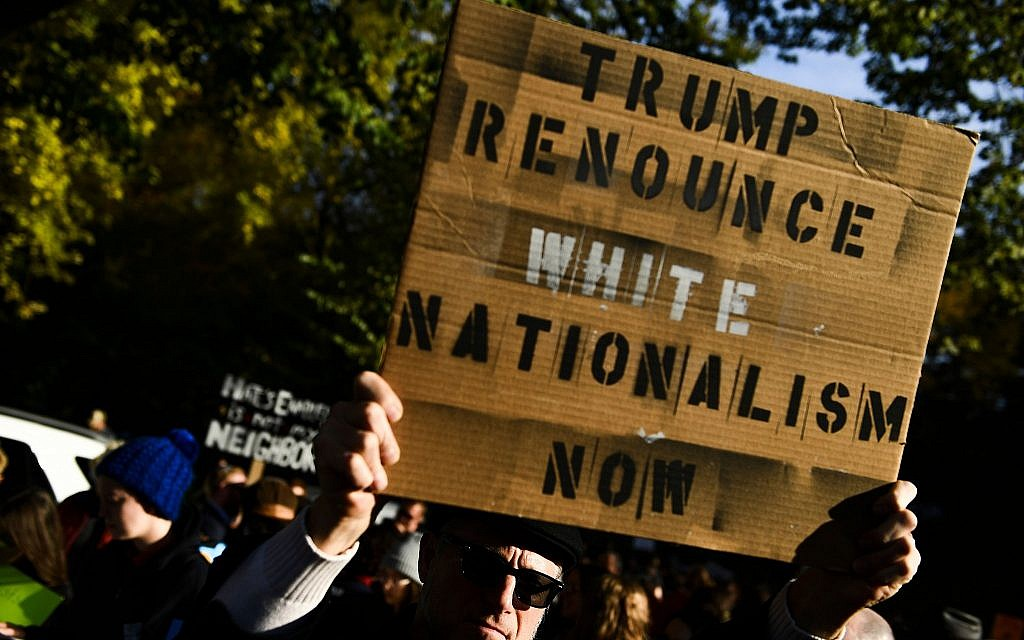 Protesters demonstrate against US President Donald Trump near the Tree of Life synagogue in Pittsburgh as he visited the site where 11 Jewish worshippers were killed, on October 30, 2018. (Brendan Smialowski/AFP/Getty Images via JTA)