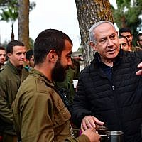 Prime Minister Benjamin Netanyahu (R) tours the northern border to see IDF operations to uncover the Hezbollah attack tunnels on December 12, 2018 (Kobi Gideon/GPO)