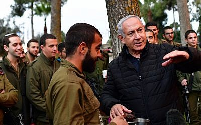 Prime Minister Benjamin Netanyahu (R) tours the northern border to see IDF operations to uncover the Hezbollah attack tunnels on December 11, 2018 (Kobi Gideon/GPO)