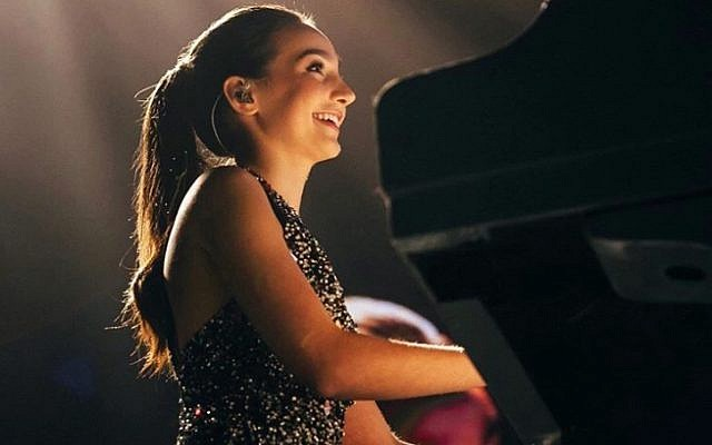 Pianist Emily Bear, a 17-year-old American prodigy, will perform at two benefit concerts with singers Avraham Tal and Ester Rada, in support of Save a Child's Heart (Courtesy PR)