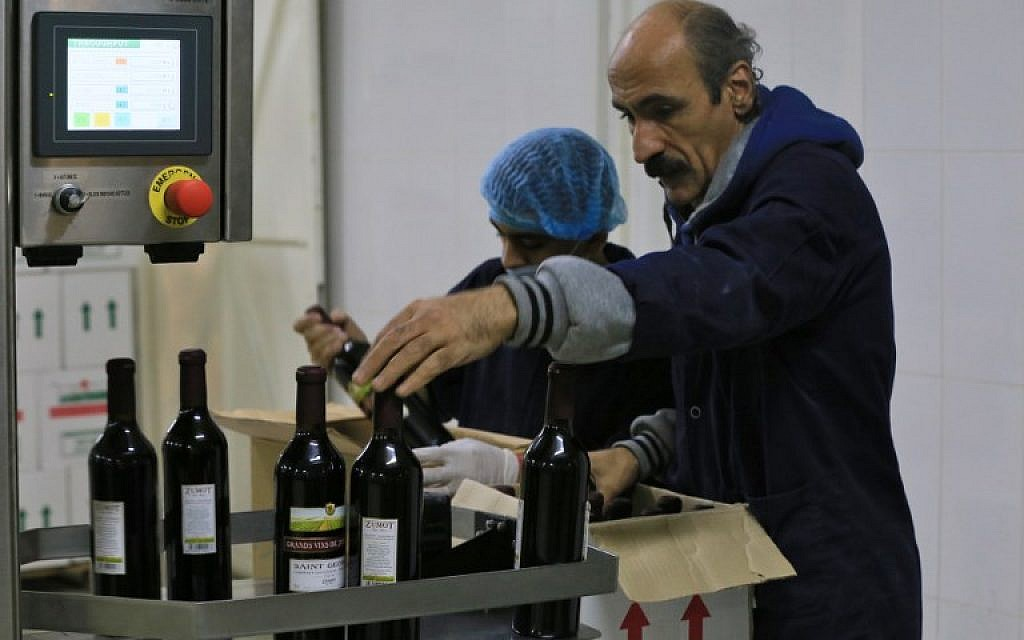 A picture taken on November 5, 2018, shows a worker inspecting bottles at the Saint George winery in Zahab, Jordan, an eastern suburb of Amman. (Laure van Ruymbeke/AFP)