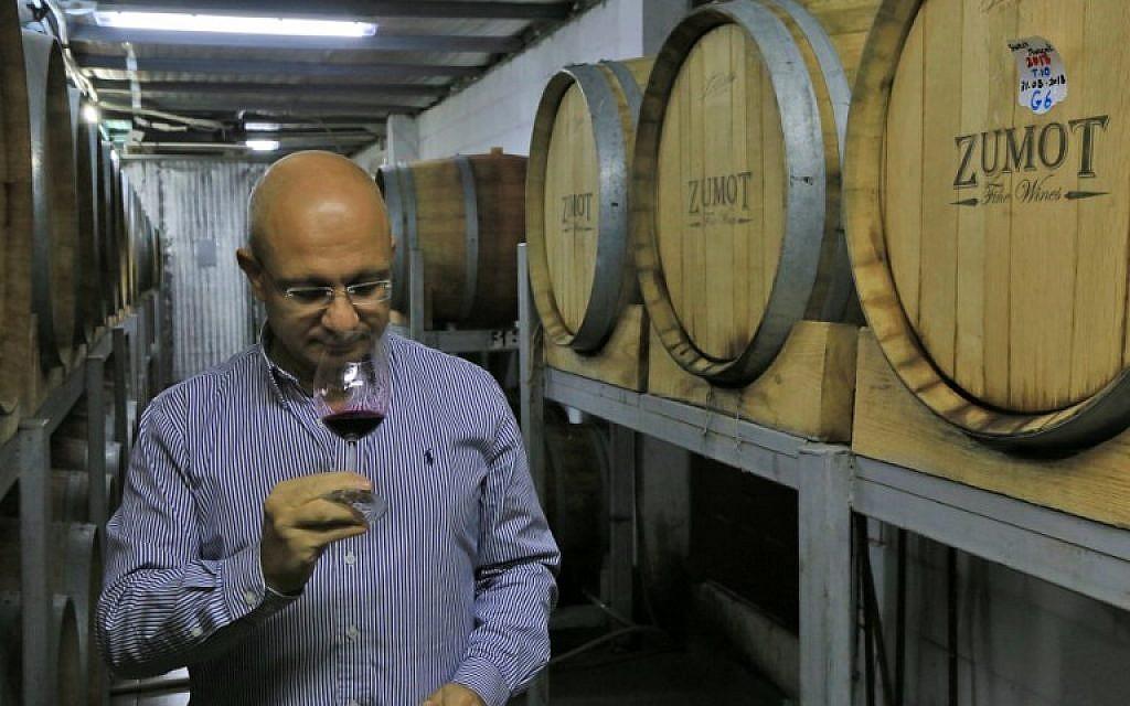 Omar Zumot, who studied winemaking in France, samples a wine inside the Saint George winery in Zahab, an eastern suburb of Amman, Jordan, on November 5, 2018. (Laure van Ruymbeke/AFP)