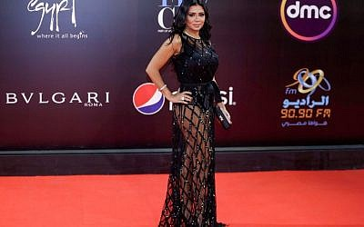 Egyptian actress Rania Youssef poses on the red carpet at the closing ceremony of the 40th edition of the Cairo International Film Festival (CIFF) at the Cairo Opera House in the Egyptian capital on November 29, 2018. (Suhail SALEH / AFP)