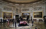 US President Donald Trump and First Lady Melania Trump pay their respects as US president George H. W. Bush lies in state in the Rotunda of the US Capitol in Washington, DC on December 3, 2018. -(Pablo Martinez Monsivais/POOL/AFP)