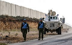 United Nations Interim Force in Lebanon (UNIFIL) soldiers patrol along the border wall with Israel near the southern Lebanese village of Kfar Kila on December 4, 2018. (Mahmoud Zayyat/AFP)