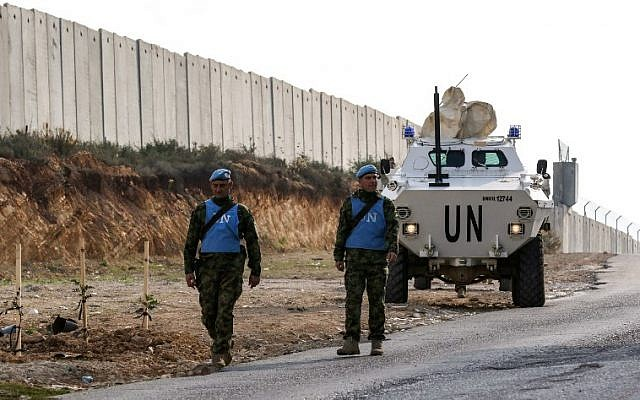 United Nations Interim Force in Lebanon (UNIFIL) soldiers patrol along the border wall with Israel near the southern Lebanese village of Kfar Kila on December 4, 2018. (Mahmoud ZAYYAT / AFP)