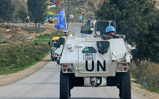 A United Nations Interim Force in Lebanon (UNIFIL) armored personnel carrier (APC) patrols along the border with Israel near the southern Lebanese village of Kfar Kila on December 4, 2018. (Mahmoud Zayyat/AFP)