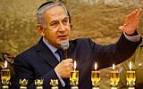 Prime Minister Benjamin Netanyahu (L) speaks during a candle lighting ceremony marking the Hanukkah festival at the Western Wall in the Old City of Jerusalem on December 6, 2018. (Gil Cohen-Magen/Pool/AFP)