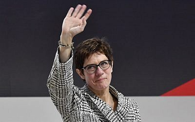 Germany's conservative Christian Democratic Union (CDU) party's Secretary General Annegret Kramp-Karrenbauer waves on stage after she was elected as party's leader during the CDU congress on December 7, 2018 at a fair hall in Hamburg, northern Germany. (John MacDougall/AFP)