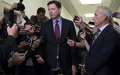 Former FBI Director James Comey (C) talks to reporters following a closed House Judiciary Committee meeting to hear his testimony, on Capitol Hill in Washington, DC, on December 7, 2018. (Alex Edelman / AFP)