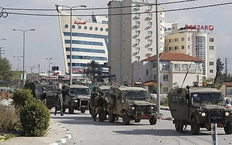 Israeli soldiers deploy during clashes in the West Bank city of Ramallah following a raid on December 10, 2018, one day after a drive-by shooting attack next to a settlement in which many Israelis were injured. (ABBAS MOMANI / AFP)