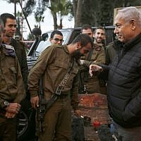 Prime Minister Benjamin Netanyahu (R), accompanied by Maj. Gen. Yoel Strick (L), commander of the Israel Defense Forces Northern Command, meets with soldiers in the northern city of Safed on December 11, 2018. (Jalaa Marey/AFP)
