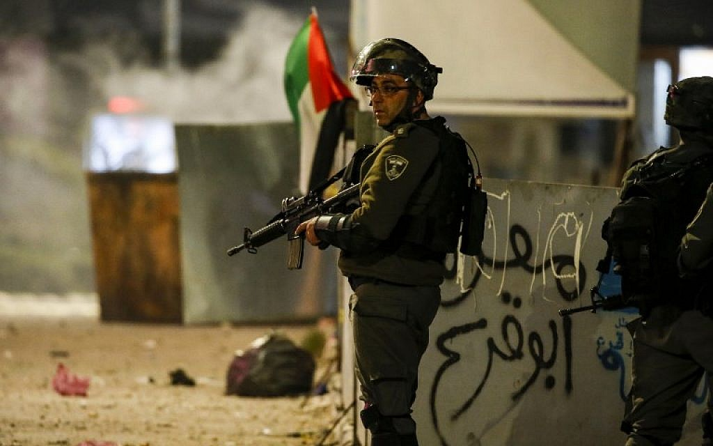 An Israeli border guard stands during clashes with Palestinian protesters in the West Bank city of Ramallah on December 11, 2018.  (ABBAS MOMANI / AFP)