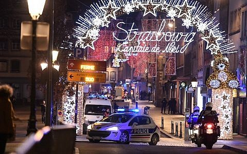 A police car drives in the streets of Strasbourg, eastern France, after a shooting, on December 11, 2018 (Frederick FLORIN / AFP)