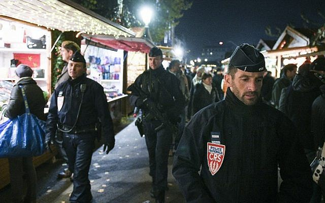 In this file photo taken on November 23, 2018 French policemen of the CRS company patrol in Strasbourg, eastern France, on the opening day of the city's Christmas market, the largest and one of the oldest Christmas markets in France (SEBASTIEN BOZON / AFP)