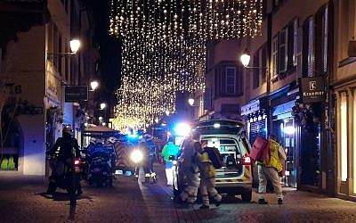 Rescuers walk in the streets of Strasbourg, eastern France, after a shooting at a Christmas market, on December 11, 2018. (François D'Astier/AFP)