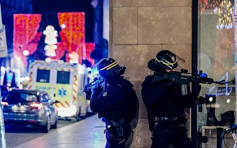 French police officers near the scene of a shooting at a Christmas market on December 11, 2018 in Strasbourg, eastern France. (Abdesslam Mirdass/AFP)
