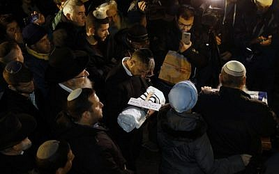 Relatives of Amichai and Shira Ish-Ran attend the funeral of their baby, who was born prematurely after his mother was wounded in a terror attack outside the West Bank settlement of Ofra, at Mount of Olives ceremony in Jerusalem on December 12, 2018. (AFP)