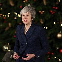 Britain's Prime Minister Theresa May makes a statement outside 10 Downing Street in central London after winning a confidence vote on December 12, 2018. (Daniel Leal-Olivas/AFP)