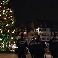 Police officers patrol on December 13, 2018, in Strasbourg eastern France, near the Christmas market, after a shooting breakout, on December 11, 2018. (Alain Jocard/AFP)