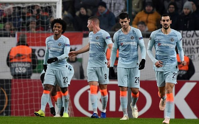 Chelsea's Brazilian midfielder Willian (L) is congratulated by teammates Ross Barkley, Álvaro Morata and Davide Zappacosta (R) after scoring during a UEFA Europa League Group soccer match between MOL Vidi FC and Chelsea on December 13, 2018, in Budapest, Hungary. (Attila Kisbenedek/AFP)