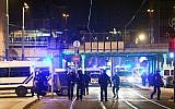 French police officers block the road near the site where Cherif Chekatt, the alleged gunman who had been on the run since allegedly killing three people at Strasbourg's popular Christmas market, was shot dead by police in the Neudorf neighborhood of Strasbourg on December 13, 2018. (Alain JOCARD/AFP)