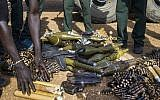 In this file photo taken on April 25, 2016, rebel troops of the Sudan People's Liberation Army in Opposition (SPLA-IO) unload their weapons at their military site in Juba. (Albert Gonzalez Farran / AFP)