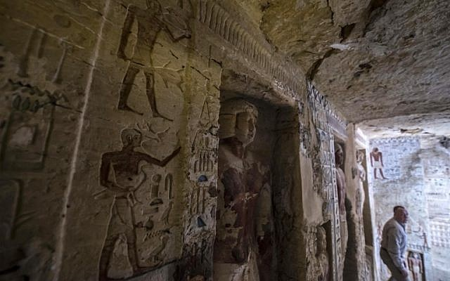 """Mostafa Waziri, Secretary General of Egypt's Supreme Council of Antiquities, walks in a newly-discovered tomb at the Saqqara necropolis, 30 kilometres south of the Egyptian capital Cairo, on December 15, 2018, belonging to the high priest """"Wahtye"""" who served during the fifth dynasty reign of King Neferirkare (between 2500-2300 BC).  (Khaled DESOUKI / AFP)"""