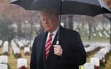 US President Donald Trump walks past tombstones during an unscheduled visit to Arlington National Cemetery on December 15, 2018 in Arlington, Virginia. (ROBERTO SCHMDIT / AFP)
