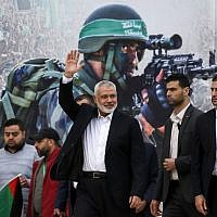 Hamas leader Ismail Haniyeh (3rd-R) waves upon his arrival at a rally marking the 31st anniversary of the terror group's founding, in Gaza City December 16, 2018. (Said Khatib/AFP)