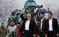 Gaza Hamas leader Ismail Haniyeh (3rd-R) waves upon his arrival at a rally marking the 31st anniversary of Hamas' founding, in Gaza City December 16, 2018. (SAID KHATIB / AFP)