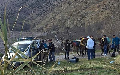 An image grab taken from a video broadcast in Morocco's news channel 2M on December 18, 2018 shows police officers and locals at the scene of a crime where the bodies of two Scandinavian women were found the day before in an isolated mountainous area 10 kilometers (six miles) from the tourist village of Imlil in the High Atlas range. (AFP)