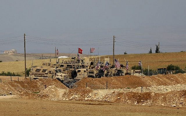 Vehicles of the US-backed coalition forces in the northern Syrian town of Manbij, May 8, 2018. (Delil souleiman/AFP)