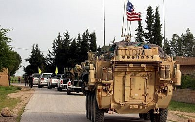 In this photo from April 28, 2017, US forces, accompanied by Kurdish People's Protection Units (YPG) fighters, drive their armored vehicles near the northern Syrian village of Darbasiyah, on the border with Turkey. (Delil Souleiman/AFP)