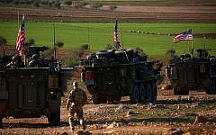 US forces armored vehicles drive near the village of Yalanli, on the western outskirts of the northern Syrian city of Manbij, March 5, 2017. (DELIL SOULEIMAN/AFP)