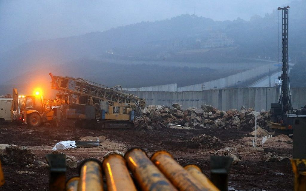A picture taken on December 19, 2018 shows a view of Israeli excavation equipment at work near the concrete barrier along the border with Lebanon, near the northern Israeli town of Metula. (JACK GUEZ / AFP)