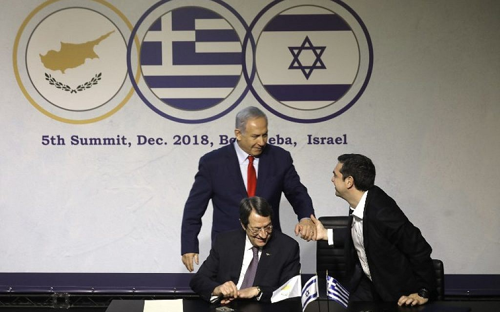 Prime Minister Benjamin Netanyahu, left, his Greek counterpart Alexis Tsipras, right,  and Cypriot President Nicos Anastasiades attend the 5th Israel-Greece-Cyprus summit, to sign trilateral agreements in cyber and innovation, in Beersheba, Israel, December 20, 2018. (Menahem Kahana/AFP)