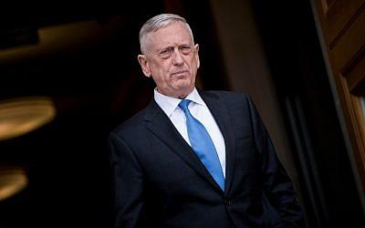 US Secretary of Defense James Mattis arrives to greet incoming National Security Adviser John Bolton, outside the Pentagon before a meeting in Washington, DC, March 29, 2018. (Brendan Smialowski/AFP)