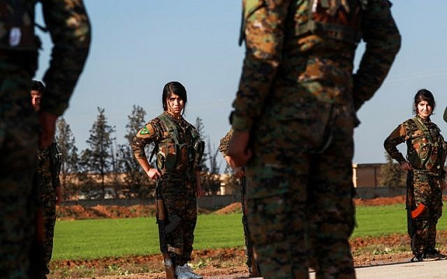 Illustrative: Fighters from the Kurdish women's protection units (YPJ) attend the funeral of an Arab fighter of the Syrian Democratic Forces (SDF) in the town of Tal Tamr in the countryside of Syria's northeastern Hasakeh province on December 21, 2018. (Delil Souleiman/AFP)